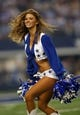 Sep 8, 2013; Arlington, TX, USA; A Dallas Cowboys cheerleader performs during the game against the New York Giants at AT&T Stadium. The Dallas Cowboys beat the New York Giants 36-31. Mandatory Credit: Tim Heitman-USA TODAY Sports