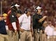 Sep 7, 2013; Norman, OK, USA; Oklahoma Sooners defensive coordinator Mike Stoops (right) linebacker coach Tim Kish (center) and defensive line coach Jerry Montgomery during the game against the West Virginia Mountaineers at Gaylord Family - Oklahoma Memorial Stadium. Mandatory Credit: Matthew Emmons-USA TODAY Sports