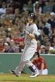 Sep 13, 2013; Boston, MA, USA; New York Yankees shortstop Brendan Ryan (35) crosses home plate after hitting a home run during the third inning against the Boston Red Sox at Fenway Park. Mandatory Credit: Bob DeChiara-USA TODAY Sports