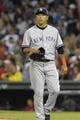Sep 13, 2013; Boston, MA, USA; New York Yankees starting pitcher Hiroki Kuroda (18) walks to the dugout after being relieved during the seventh inning against the Boston Red Sox at Fenway Park. Mandatory Credit: Bob DeChiara-USA TODAY Sports