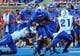 Sep 13, 2013; Boise, ID, USA; Boise State Broncos running back Jay Ajayi (27) runs through the tackle of Air Force Falcons linebacker Spencer Proctor (36) during the first half at Bronco Stadium. Mandatory Credit: Brian Losness-USA TODAY Sports
