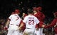 Sep 13, 2013; St. Louis, MO, USA; St. Louis Cardinals shortstop Pete Kozma (38) is mobbed by teammates after scoring on a pass ball during the tenth inning against the Seattle Mariners at Busch Stadium. St. Louis defeated Seattle 2-1 in 10 innings. Mandatory Credit: Jeff Curry-USA TODAY Sports