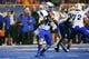 Sep 13, 2013; Boise, ID, USA; Air Force Falcons quarterback Jaleel Awini (12) drops back to pass during the second half against the Boise State Broncos at Bronco Stadium. Boise State defeated Air Force 42-20. Mandatory Credit: Brian Losness-USA TODAY Sports