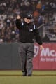 September 9, 2013; San Francisco, CA, USA; MLB umpire Greg Gibson (53) signals during the sixth inning between the San Francisco Giants and the Colorado Rockies at AT&T Park. The Giants defeated the Rockies 3-2 in 10 innings. Mandatory Credit: Kyle Terada-USA TODAY Sports