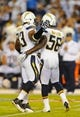 Sep 9, 2013; San Diego, CA, USA; San Diego Chargers linebacker Donald Butler (56) and linebacker Dwight Freeney (93) after a sack during the second half against the San Diego Chargers at Qualcomm Stadium. Mandatory Credit: Christopher Hanewinckel-USA TODAY Sports