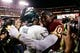 Sep 9, 2013; Landover, MD, USA; Philadelphia Eagles quarterback Michael Vick (7) and and Washington Redskins quarterback Robert Griffin III (10) hug after their game at FedEx Field. Mandatory Credit: Geoff Burke-USA TODAY Sports