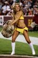 Sep 9, 2013; Landover, MD, USA; A Washington Redskins cheerleader dances on the field against the Philadelphia Eagles at FedEx Field. Mandatory Credit: Geoff Burke-USA TODAY Sports