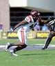 Sep 14, 2013; Greenville, NC, USA;  Virginia Tech Hokies defensive end J.R. Collins (42) rushes the passer during a game against the East Carolina Pirates at Dowdy-Ficklen Stadium. Mandatory Credit: Rob Kinnan-USA TODAY Sports