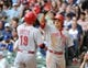 Sep 14, 2013; Milwaukee, WI, USA;  Cincinnati Reds first baseman Joey Votto (left) is greeted by center fielder Shin-Soo Choo after hitting a 2-run homer in the sixth inning against the Milwaukee Brewers at Miller Park. Mandatory Credit: Benny Sieu-USA TODAY Sports