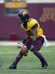 Sep 14, 2013; Minneapolis, MN, USA; Minnesota Golden Gophers quarterback Conor Rhoda (15) fumbles the ball on a punt in the third quarter against the Western Illinois Leathernecks at TCF Bank Stadium. The Gophers won 29-12. Mandatory Credit: Jesse Johnson-USA TODAY Sports
