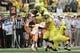 Sep 14, 2013; Eugene, OR, USA; Oregon Ducks quarterback Marcus Mariota (8) jumps over Tennessee Volunteers defensive back LaDarrell McNeil (33) at Autzen Stadium. Mandatory Credit: Scott Olmos-USA TODAY Sports