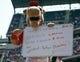 Sep 14, 2013; Arlington, TX, USA; Texas Rangers mascot Rangers Captain holds a sign between innings against the Oakland Athletics at Rangers Ballpark in Arlington. The Athletics won 1-0. Mandatory Credit: Jim Cowsert-USA TODAY Sports