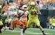 Sep 14, 2013; Eugene, OR, USA; Oregon Ducks tight end John Mundt (83) stiff arms Tennessee Volunteers defensive back Cameron Sutton (23) at Autzen Stadium. Mandatory Credit: Scott Olmos-USA TODAY Sports