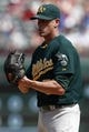 Sep 14, 2013; Arlington, TX, USA; Oakland Athletics relief pitcher Grant Balfour (50) looks for the signal against the Texas Rangers during the ninth inning of a baseball game at Rangers Ballpark in Arlington. The Athletics won 1-0. Mandatory Credit: Jim Cowsert-USA TODAY Sports