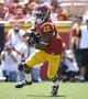 Sep 14, 2013; Los Angeles, CA, USA; USC Trojans running back Justin Davis (22) carries the ball for 3 yards during first half action against Boston College at Los Angeles Memorial Coliseum. The Trojans went on to a 35-7 win, Davis had 96 yards on 10 carries and scored a touchdown. Mandatory Credit: Robert Hanashiro-USA TODAY Sports