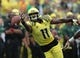Sep 14, 2013; Eugene, OR, USA; Oregon Ducks wide receiver Bralon Addison (11) reaches for a pass in the second half against the Tennessee Volunteers at Autzen Stadium. Mandatory Credit: Scott Olmos-USA TODAY Sports