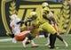 Sep 14, 2013; Eugene, OR, USA; Tennessee Volunteers defensive back Justin Coleman (27) tackles Oregon Ducks tight end John Mundt (83) at Autzen Stadium. Mandatory Credit: Scott Olmos-USA TODAY Sports