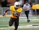 Sep 14, 2013; Laramie, WY, USA; Wyoming Cowboys safety Darrenn White (13) runs an apparent fumble back against the Northern Colorado Bears  during the fourth quarter at War Memorial Stadium. Mandatory Credit: Troy Babbitt-USA TODAY Sports