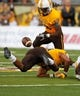 Sep 14, 2013; Laramie, WY, USA; Wyoming Cowboys safety Darrenn White (13) looks to recover an apparent fumble back against the Northern Colorado Bears during the fourth quarter at War Memorial Stadium. Mandatory Credit: Troy Babbitt-USA TODAY Sports
