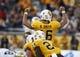 Sep 14, 2013; Laramie, WY, USA; Wyoming Cowboys quarterback Brett Smith (16) calls a signal against the Northern Colorado Bears during the third quarter at War Memorial Stadium. Mandatory Credit: Troy Babbitt-USA TODAY Sports