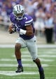 Sep 14, 2013; Manhattan, KS, USA; Kansas State Wildcats defensive back Kip Daily (7) returns an interception 38 yards for a touchdown during a game against the Massachusetts Minutemen at Bill Snyder Family Stadium. Mandatory Credit: Scott Sewell-USA TODAY Sports