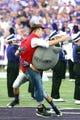 Sep 14, 2013; Manhattan, KS, USA; Kansas State Wildcats mascot Willie Wildcat tackles a fake Massachusetts Minutemen mascot before the start of a game at Bill Snyder Family Stadium. Mandatory Credit: Scott Sewell-USA TODAY Sports