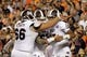 Sep 14, 2013; Auburn, AL, USA; Mississippi State Bulldogs quarterback Dak Prescott (15) celebrates with linemen Dillon Day (63) and Ben Beckwith (66) after scoring a touchdown against the Auburn Tigers during the first half at Jordan Hare Stadium. Mandatory Credit: John Reed-USA TODAY Sports