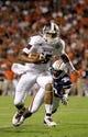 Sep 14, 2013; Auburn, AL, USA; Mississippi State Bulldogs quarterback Dak Prescott (15) avoids the tackle of Auburn Tigers defensive end Dee Ford (30) during the first half at Jordan Hare Stadium. Mandatory Credit: John Reed-USA TODAY Sports