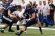 Sep 14, 2013; Logan, UT, USA; Utah State Aggies linebacker Kyler Fackrell (9) tackles Weber State Wildcats running back Josh Booker (24) during the second quarter at Romney Stadium. Mandatory Credit: Chris Nicoll-USA TODAY Sports
