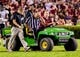 Sep 14, 2013; Columbia, SC, USA; Head linesman Gus Morris III is carted of the field after being injured in the second quarter between the South Carolina Gamecocks  and the Vanderbilt Commodores at Williams-Brice Stadium. Mandatory Credit: Jeff Blake-USA TODAY Sports