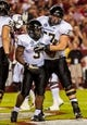 Sep 14, 2013; Columbia, SC, USA; Vanderbilt Commodores running back Jerron Seymour (3) and Vanderbilt Commodores offensive linesman Spencer Pulley (77) celebrate a Seymour touchdown against the South Carolina Gamecocks in the second quarter at Williams-Brice Stadium. Mandatory Credit: Jeff Blake-USA TODAY Sports