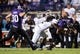 Sep 14, 2013; Evanston, IL, USA; Northwestern Wildcats quarterback Kain Colter (2) is tackled by Western Michigan Broncos safety Demetrius Pettway (2) during the first quarter at Ryan Field. Mandatory Credit: Jerry Lai-USA TODAY Sports