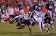Sep 14, 2013; Auburn, AL, USA; Auburn Tigers quarterback Nick Marshall (14) is brought down by Mississippi State Bulldogs linebacker Richie Brown (39) at Jordan Hare Stadium. Mandatory Credit: Shanna Lockwood-USA TODAY Sports