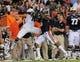 Sep 14, 2013; Auburn, AL, USA; Auburn Tigers defensive back Jonathon Mincy (6) breaks up a pass to Mississippi State Bulldogs wide receiver Joe Morrow (16) at Jordan Hare Stadium. Mandatory Credit: Shanna Lockwood-USA TODAY Sports