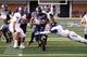 Sep 14, 2013; Logan, UT, USA; Utah State Aggies running back Rashad Hall (20) runs past two Weber State Wildcats during first quarter at Romney Stadium. Mandatory Credit: Chris Nicoll-USA TODAY Sports