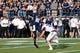 Sep 14, 2013; Logan, UT, USA; Utah State Aggies quarterback Chuckie Keeton (16) throws a pass over Weber State Wildcats safety Chris Wheeler (37) during the first quarter at Romney Stadium. Mandatory Credit: Chris Nicoll-USA TODAY Sports