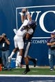 Sep 14, 2013; Logan, UT, USA; Utah State Aggies wide receiver Bruce Natson (9) out jumps Weber State Wildcats cornerback Cordero Dixon (2) and catches the ball for a touchdown during the second quarter at Romney Stadium. Mandatory Credit: Chris Nicoll-USA TODAY Sports