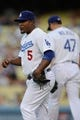 Sep 14, 2013; Los Angeles, CA, USA; Los Angeles Dodgers third baseman Juan Uribe (5) reacts after he commits an error against the San Francisco Giants during the first inning at Dodger Stadium. Mandatory Credit: Kelvin Kuo-USA TODAY Sports