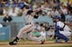 Sep 14, 2013; Los Angeles, CA, USA; San Francisco Giants catcher Buster Posey (28) hits a single against the Los Angeles Dodgers during the first inning at Dodger Stadium. Mandatory Credit: Kelvin Kuo-USA TODAY Sports