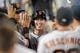 Sep 14, 2013; Los Angeles, CA, USA; San Francisco Giants pitcher Tim Lincecum (55) celebrates after running in a score against the Los Angeles Dodgers during the third inning at Dodger Stadium. Mandatory Credit: Kelvin Kuo-USA TODAY Sports