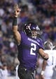 Sep 14, 2013; Evanston, IL, USA; Northwestern Wildcats quarterback Kain Colter (2) celebrates after scoring a touchdown against the Western Michigan Broncos during the second quarter at Ryan Field. Mandatory Credit: Jerry Lai-USA TODAY Sports