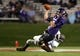 Sep 14, 2013; Evanston, IL, USA; Northwestern Wildcats quarterback Trevor Siemian (13) throws the ball away as he is pressured by Western Michigan Broncos linebacker Edward Rolle (4) during the second quarter at Ryan Field. Mandatory Credit: Jerry Lai-USA TODAY Sports