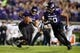 Sep 14, 2013; Evanston, IL, USA; Northwestern Wildcats running back Malin Jones (20) blocks for quarterback Kain Colter (2) during the second quarter against the Western Michigan Broncos at Ryan Field. Mandatory Credit: Jerry Lai-USA TODAY Sports