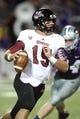 Sep 14, 2013; Manhattan, KS, USA; Massachusetts Minutemen quarterback A.J. Doyle (15) scrambles during a 37-7 loss to the Kansas State Wildcats at Bill Snyder Family Stadium. Mandatory Credit: Scott Sewell-USA TODAY Sports