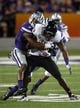 Sep 14, 2013; Manhattan, KS, USA; Massachusetts Minutemen wide receiver Derek Beck (89) is tackled by Kansas State Wildcats defensive back Kip Daily (7) during a 37-7 Minutemen loss at Bill Snyder Family Stadium. Mandatory Credit: Scott Sewell-USA TODAY Sports