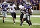 Sep 14, 2013; Manhattan, KS, USA; Kansas State Wildcats running back John Hubert (33) is tackled from behind by Massachusetts Minutemen defensive back Antoine Tharpe (2) during the Wildcats' 37-7 win at Bill Snyder Family Stadium. Mandatory Credit: Scott Sewell-USA TODAY Sports