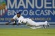 Sep 14, 2013; Los Angeles, CA, USA; Los Angeles Dodgers center fielder Yasiel Puig (66) dives for a catch against the San Francisco Giants during the fifth inning at Dodger Stadium. Mandatory Credit: Kelvin Kuo-USA TODAY Sports