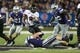 Sep 14, 2013; Manhattan, KS, USA; Massachusetts Minutemen running back Stacey Bedell (23) is tackled by Kansas State Wildcats defensive linemen Travis Britz (95), Chaquil Reed (98) and linebacker Jonathan Truman (21) during a 37-7 Minutemen loss at Bill Snyder Family Stadium. Mandatory Credit: Scott Sewell-USA TODAY Sports