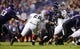 Sep 14, 2013; Evanston, IL, USA; Northwestern Wildcats running back Treyvon Green (22) is tackled by Western Michigan Broncos defensive lineman David Curle (68) during the third quarter at Ryan Field. Mandatory Credit: Jerry Lai-USA TODAY Sports