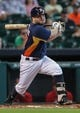 Sep 15, 2013; Houston, TX, USA; Houston Astros second baseman Jose Altuve (27) hits a single during the third inning against the Los Angeles Angels at Minute Maid Park. Mandatory Credit: Troy Taormina-USA TODAY Sports
